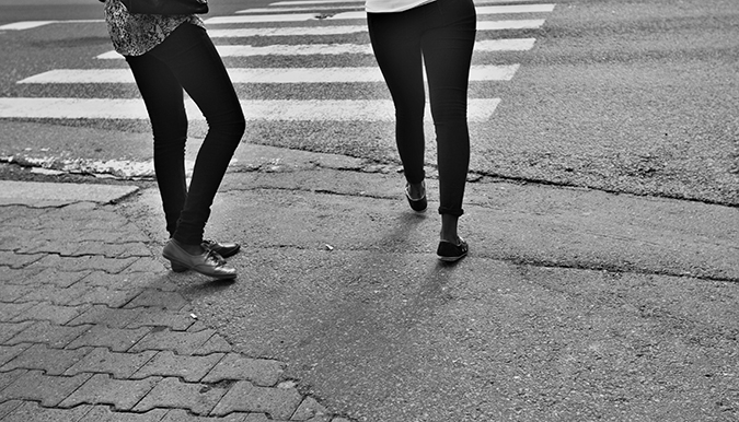 Two Young Women Crossing The Street